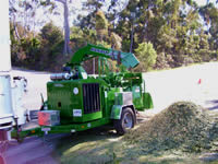 Mulching with wood chipper